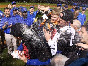 John Lester and his son during the Cubs NLDS Clinching celebration