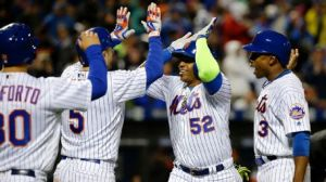Cespedes greeted by Wright, Conforto and Granderson after drigin them all home with his Grand Slam. AP Photo / Julie Jacobson